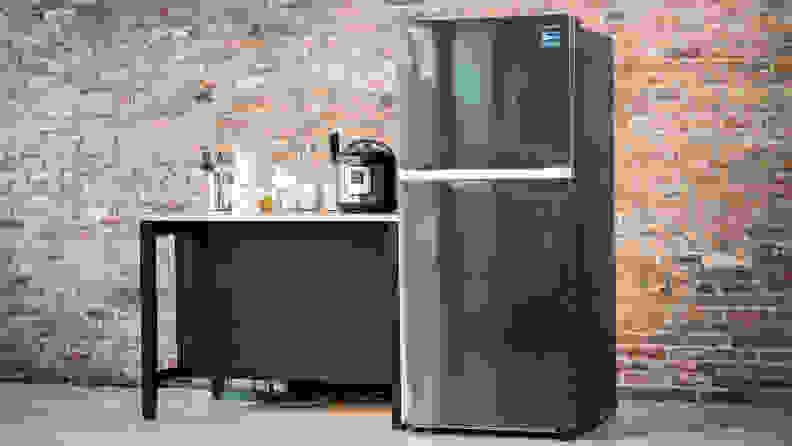 The Samsung RT18M6215SG in a red-brick kitchen.