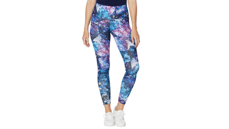 person wearing abstract leggings on white background