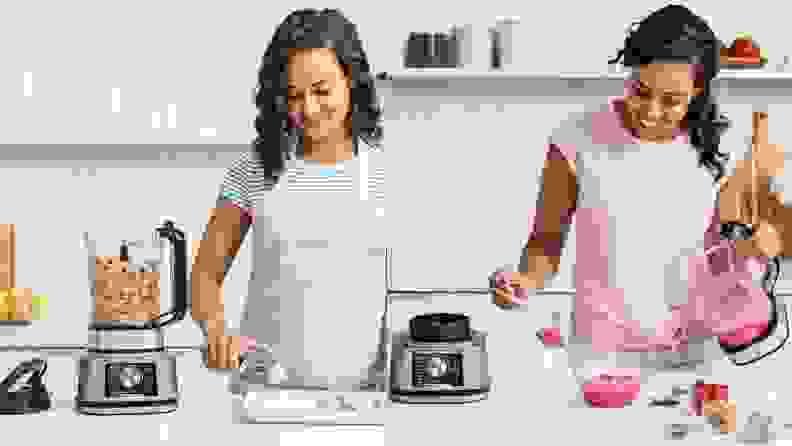 Women in kitchen blending smoothies