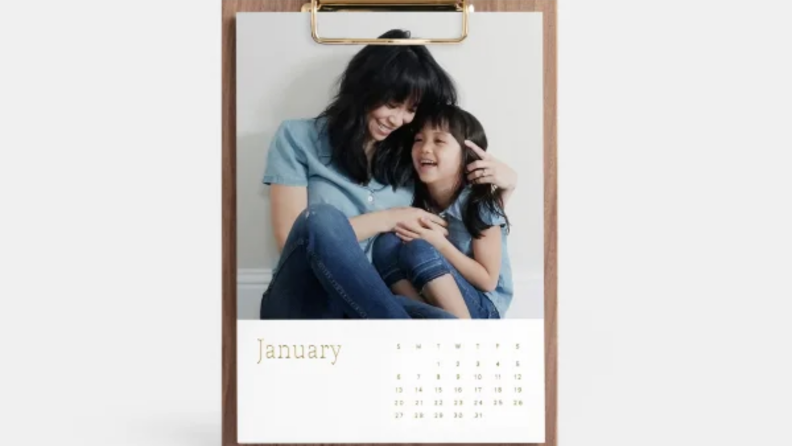 A desk calendar featuring a woman and child hugging