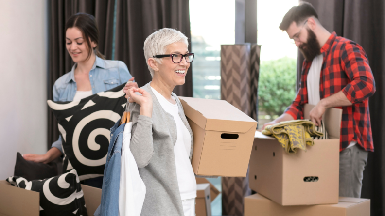 A young married couple and mother-in-law move into a new space.