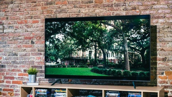 Samsung TV against a red brick wall