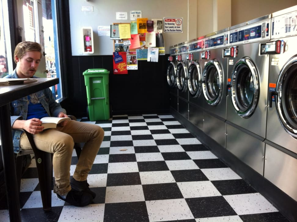 Man sitting in a laundromat