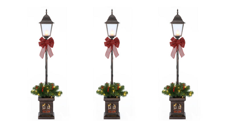 Three of the same holiday lantern decorations next to one another on a white background.