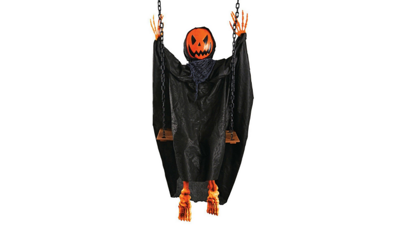 An image of a pumpkin-headed ghoul in dark robes sitting on a swing.