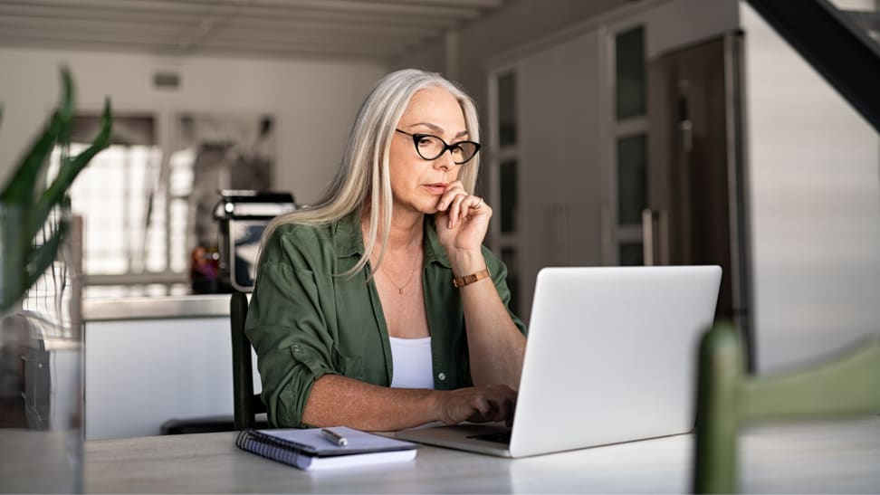 A woman checking her credit report online