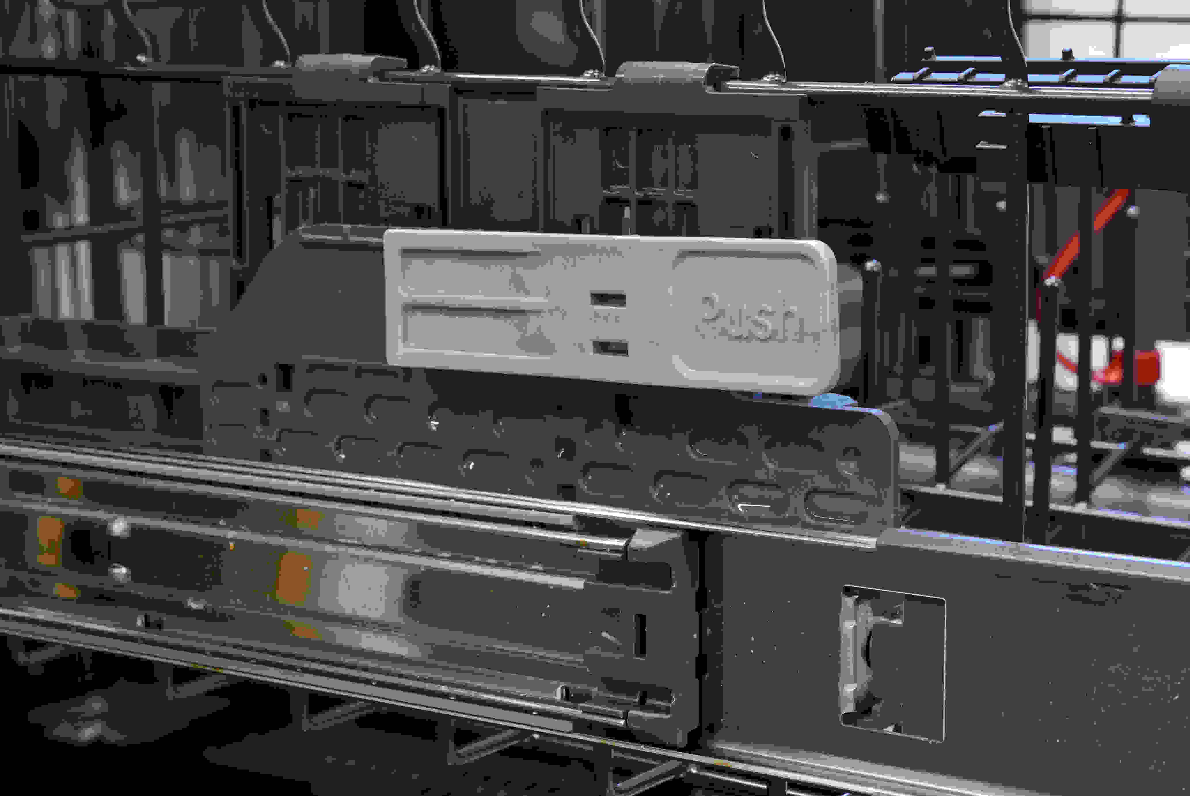 These levers are found on the side of the GE Profile PDT855S's upper rack, and allow you to adjust its height.