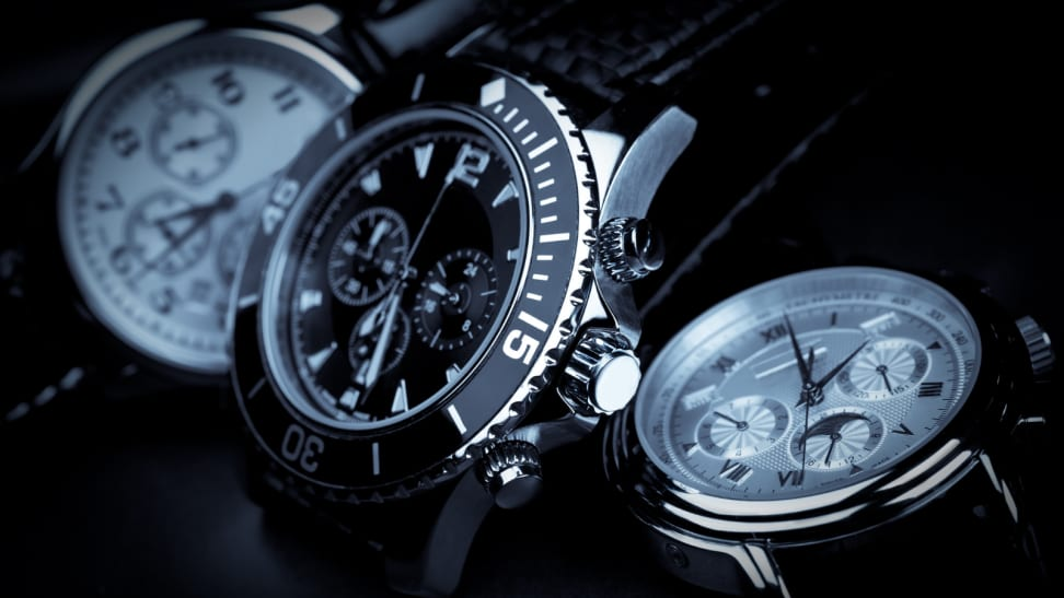 close-up of three silver wrist watches