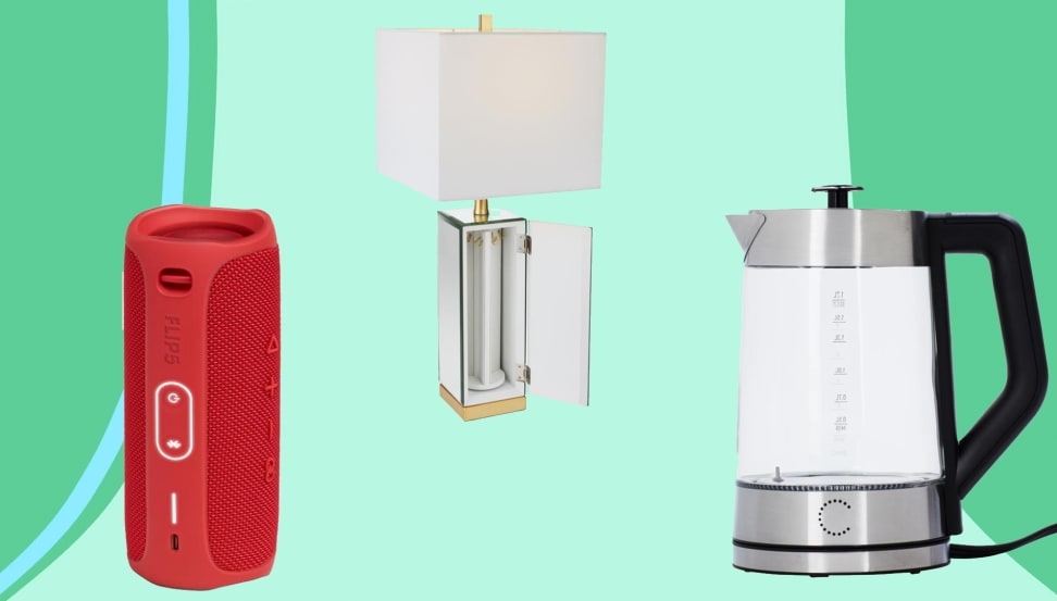 JBL speaker in red, white shaded lamp and white and steel grey kettle on green/blue background