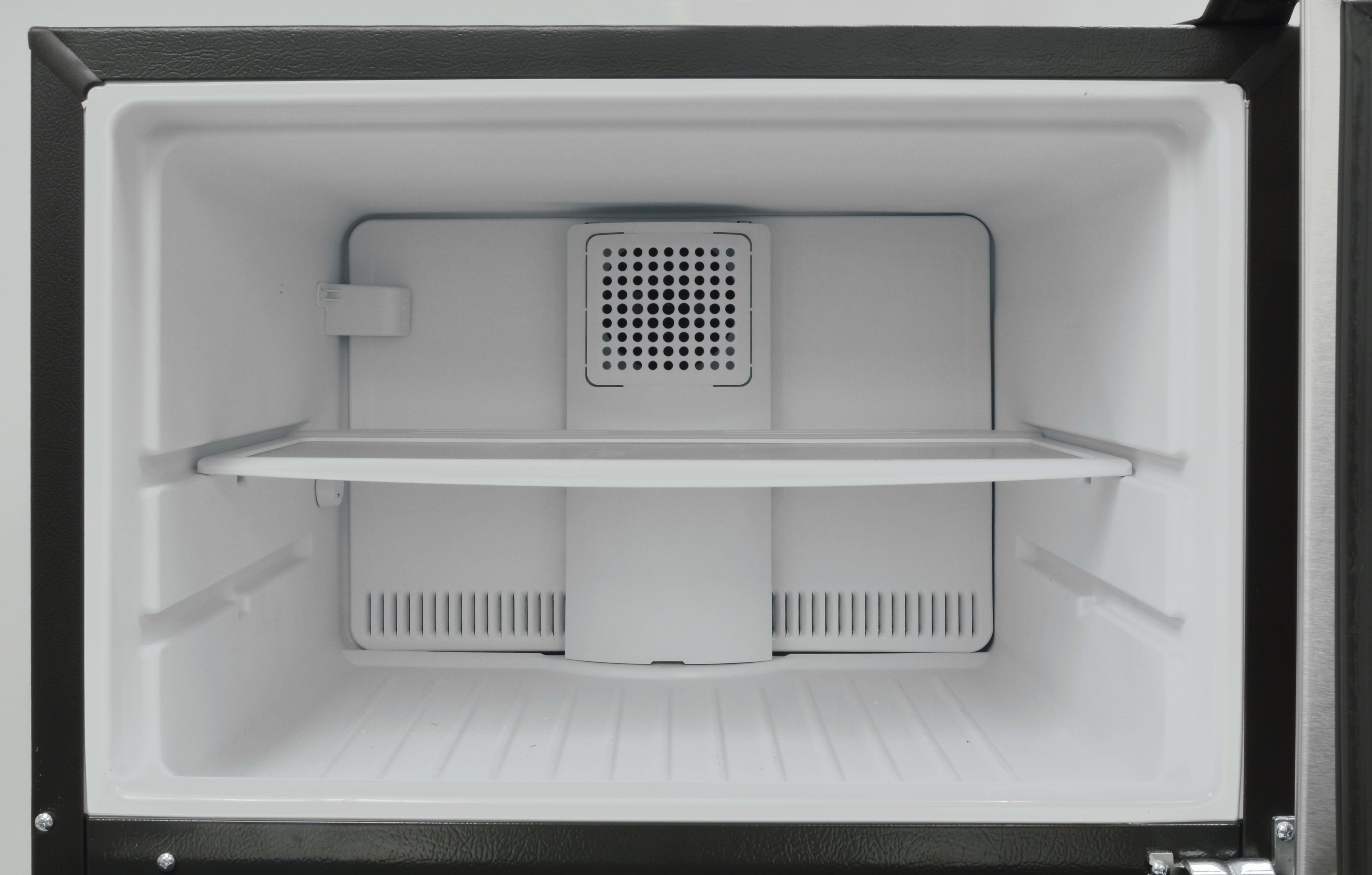 Inside the GE GAS18P's freezer, you get one adjustable shelf. No light, no ice maker; it's very basic.