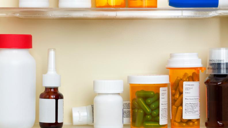 Assorted medications in medicine cabinet.