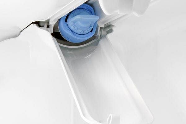 The KitchenAid KFXS25RYMS's water filter is stored in a recessed nook at the top of the fridge section.