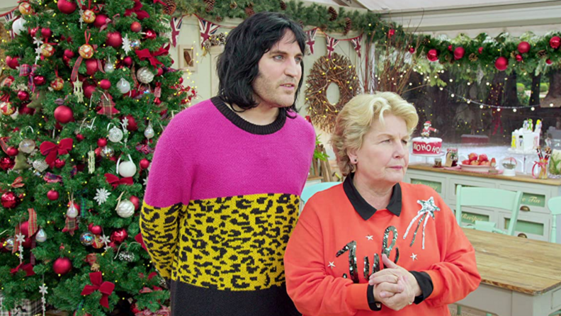A still from The Great British Baking Show featuring Sandi Tolvig and Noel Fielding