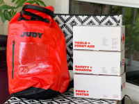 The Judy Mover Max Kit sits on a black and white chair outdoors.