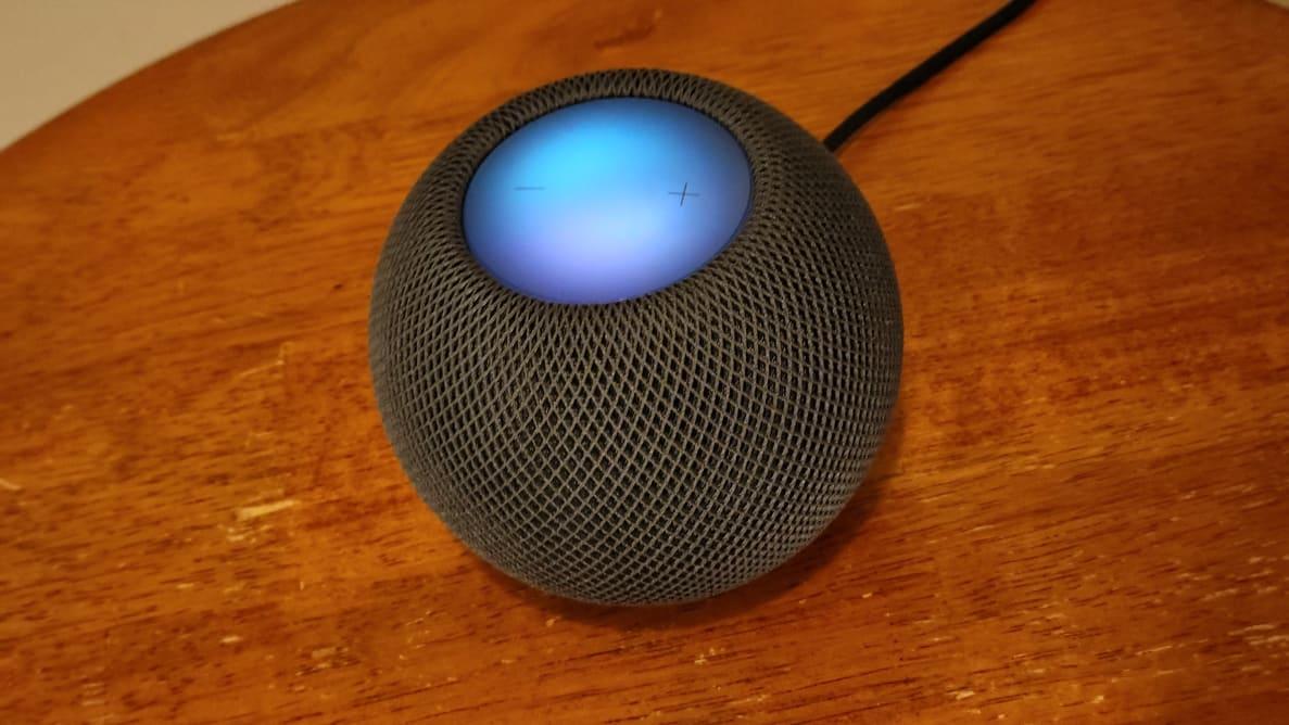 HomePod Mini with listening light illuminated