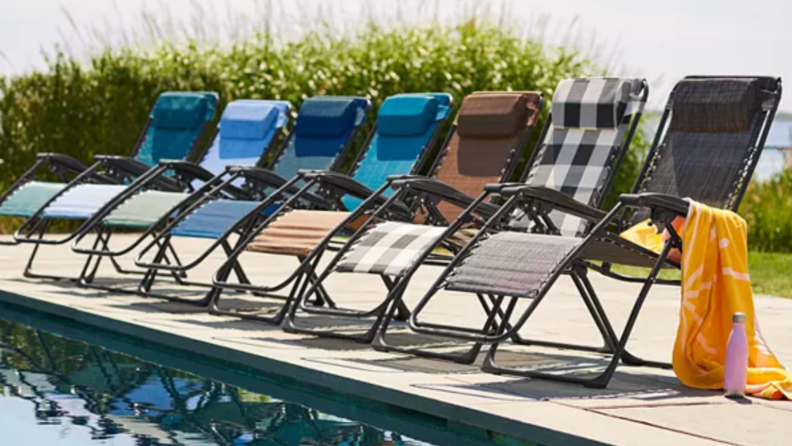 Multi-colored Kohl's Sonoma Goods For Life regular antigravity chairs lined up on pool deck.