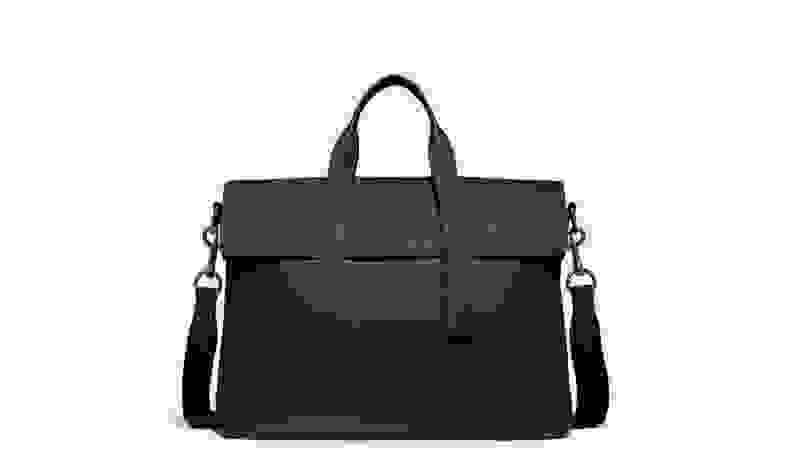 Black portfolio bag on gray background.
