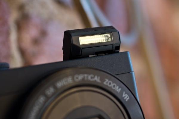 A photograph of the Nikon Coolpix P340's flash arm.