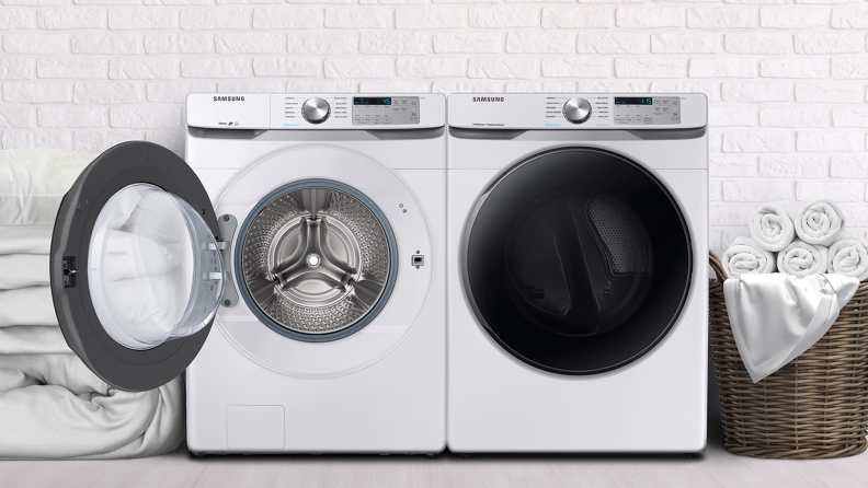 The Samsung WF45R6100AW beside a Samsung dryer in a white laundry room.
