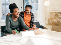 A mother and her teen daughter talking about their shared credit card