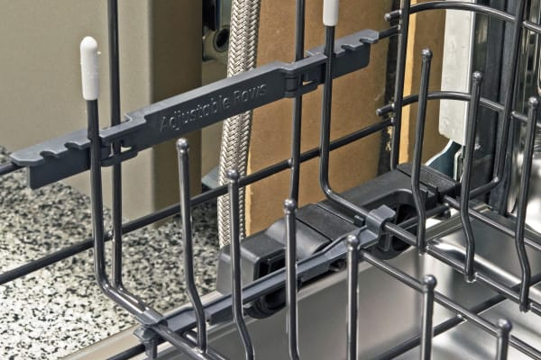 The lower rack features two rows of folding tines that offer multiple slots for various fixed widths.