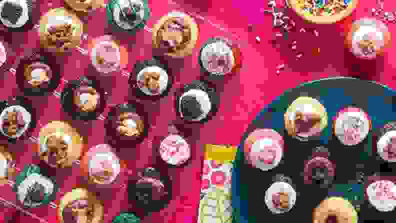 A variety of cupcakes displayed on a dessert table.