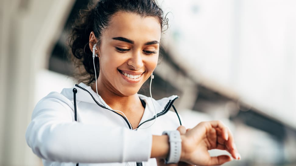 woman checking fitness tracker