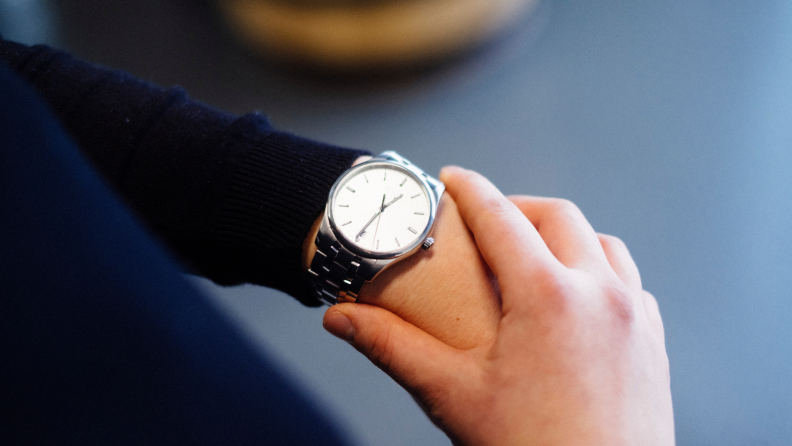 person looking at wristwatch