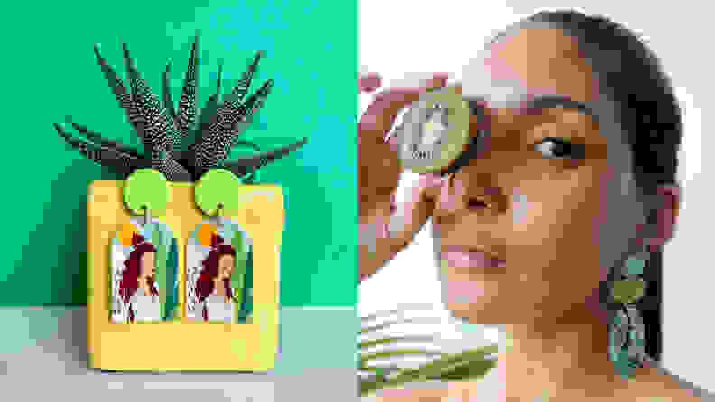 A pair of earrings on a plant next to a woman holding fruit next to her eye wearing earrings