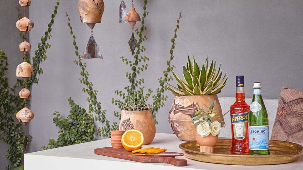 Trays, rain chains, and potted plants are great outdoor bar ideas