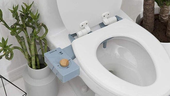 White toilet with a blue bidet attached