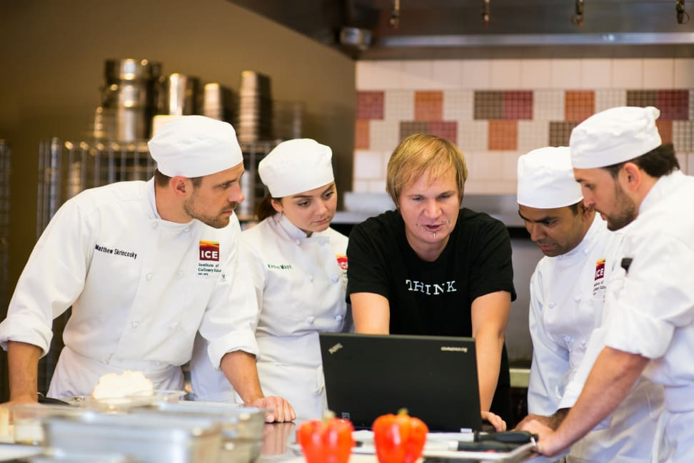 Chefs at the Institute of Culinary Education working with Watson from a laptop