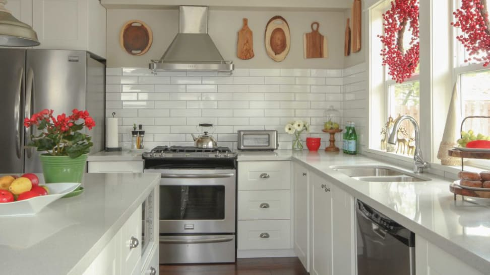 Red accents look beautiful in a white kitchen