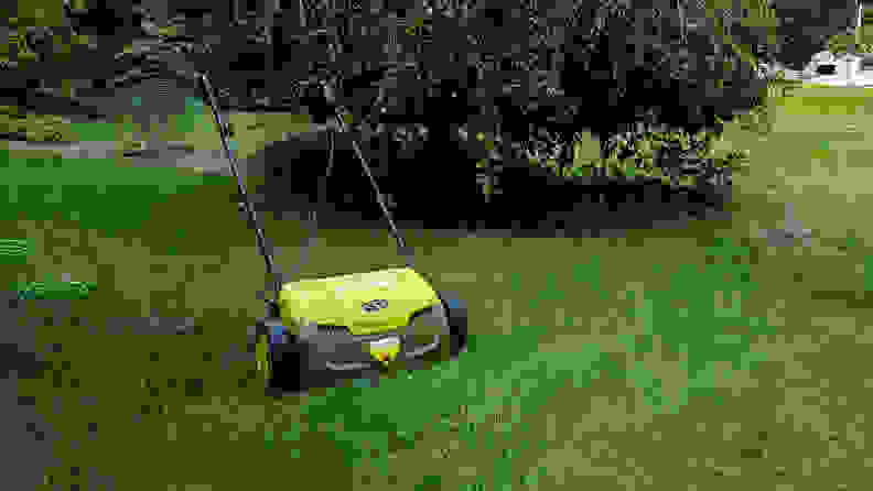A dethatcher sits on a lawn
