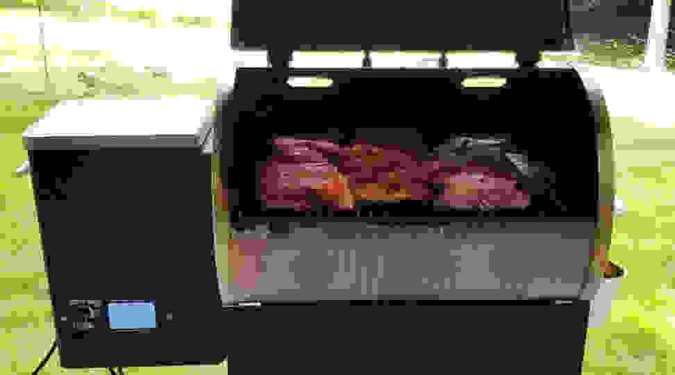 A Rec Tec grill with cooked meat inside