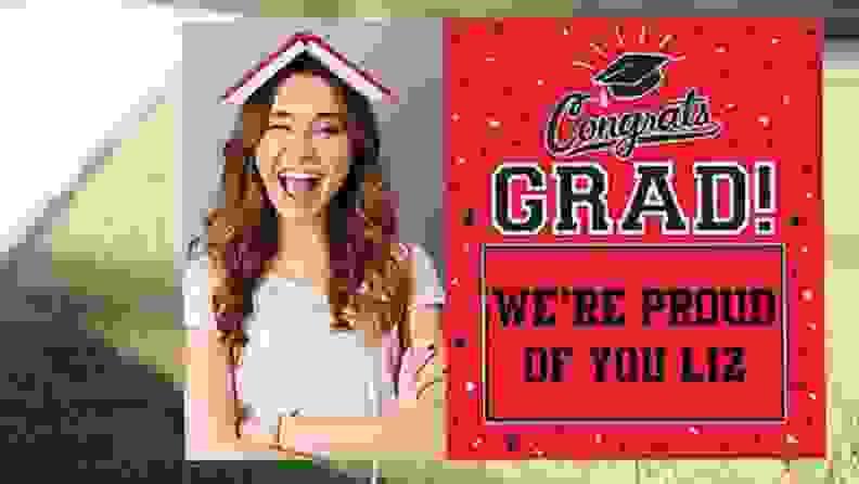A lawn sign that celebrates a recent graduate
