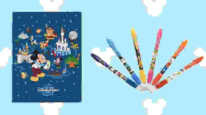mickey notebook and rainbow pens on light blue disney background
