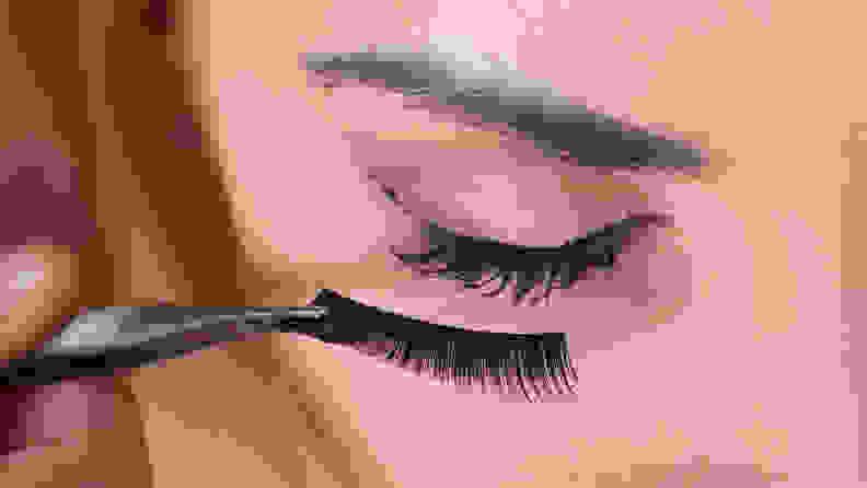 Applying fake eyelashes