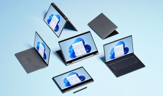 Several laptops sitting next to each other in a group