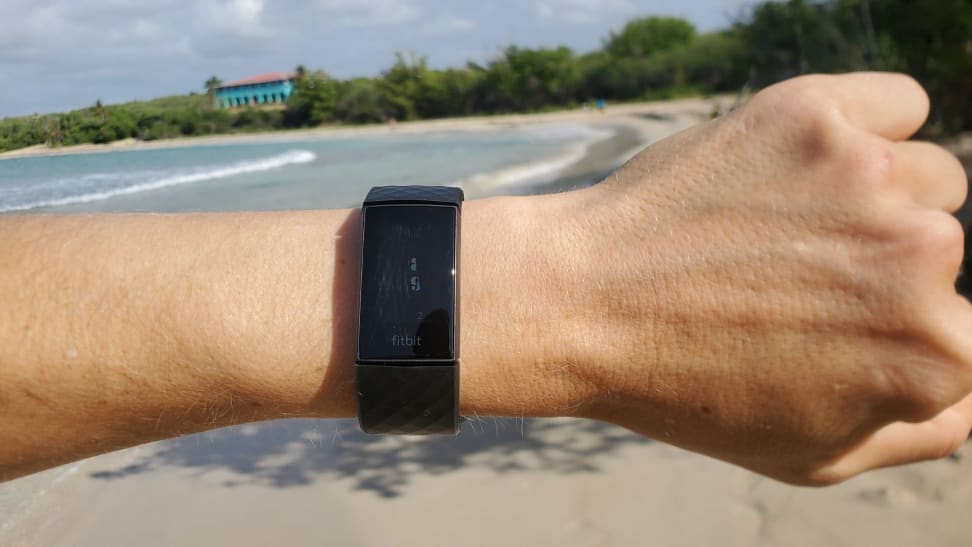 Fitbit Charge 4 testing on a beach