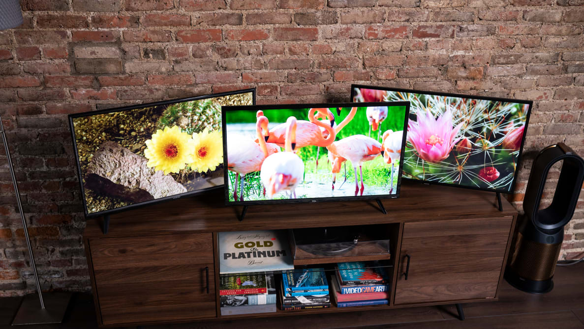 A trio of 32-inch TVs on a table