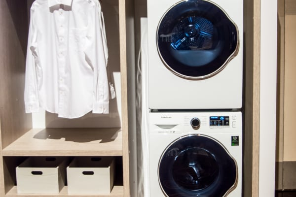 You'll save the most space if you stack the compact washer and dryer.