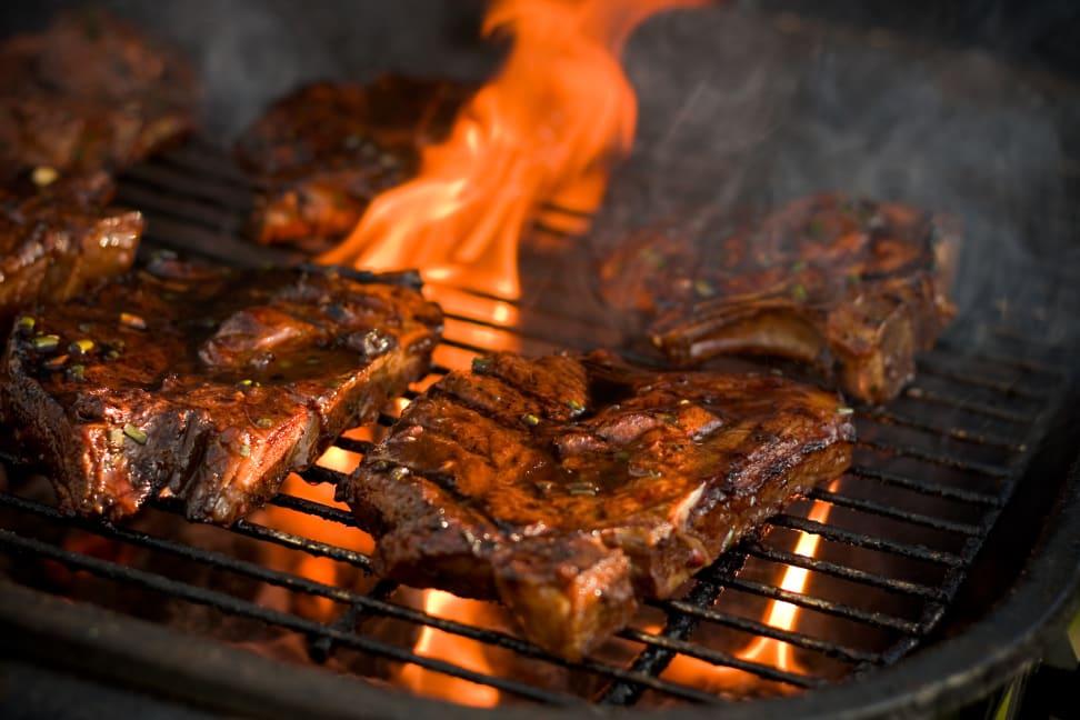 Steaks on a fiery grill