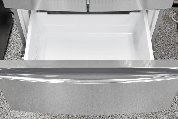 The Haier HRF15N3AGS's upper freezer bin is basically a large sliding bucket.