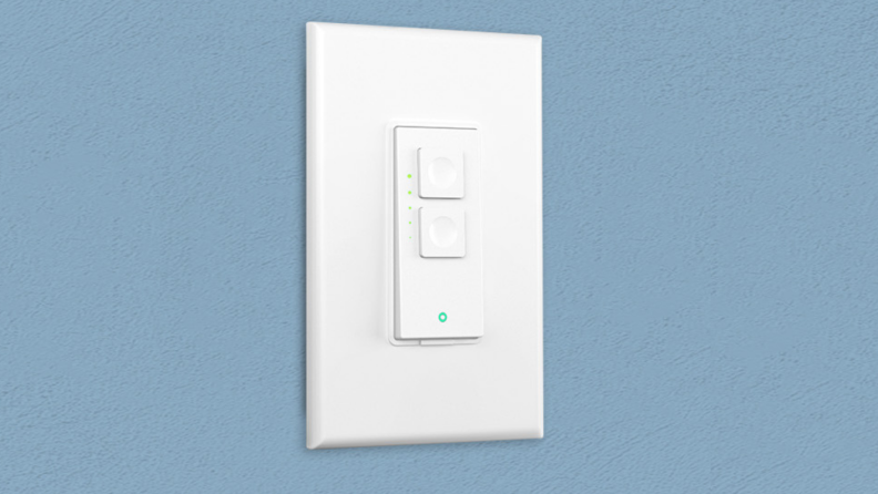 The Meross Wi-Fi Dimmer Switch installed on a blue wall.