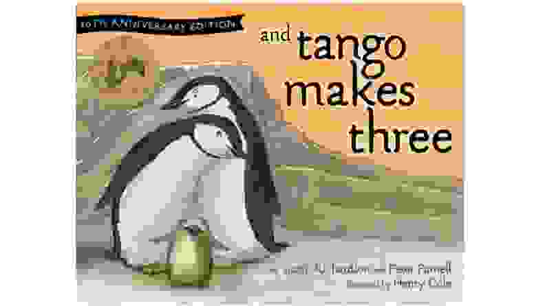 A trio of penguins cuddling