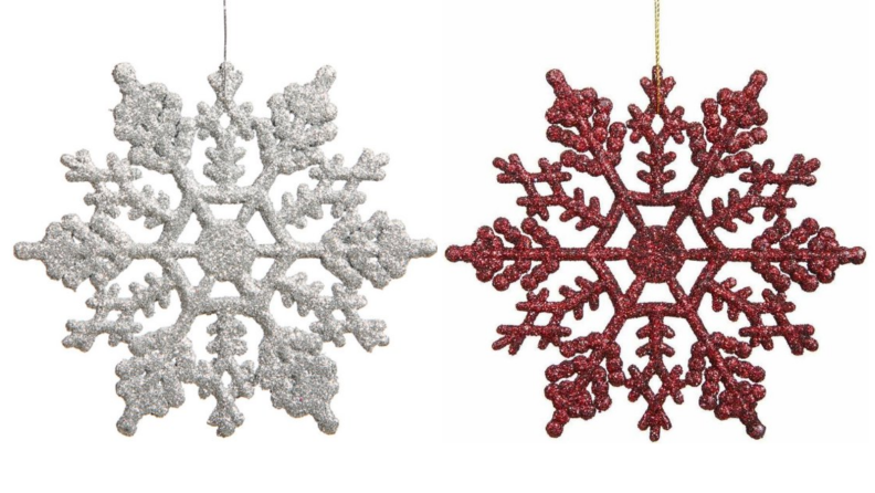 Two glittery snowflake ornaments, one white, one red, hanging together over a white background.