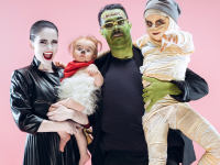 A family of ghoulish characters: A vampire mom, a Frankenstein dad, a mummy child, a werewolf baby.