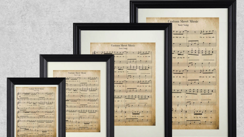 A stack of sheet music in various sizes.