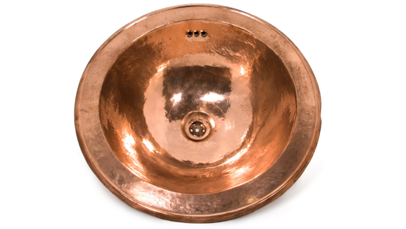 Copper round sink against a white background.